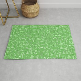 Cute cartoon dinosaur pattern on green background Rug