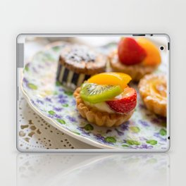 Small fruit tarts laid out on an antique china plate Laptop & iPad Skin
