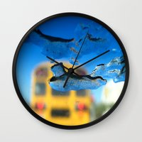 sia Wall Clocks featuring yellow bus and ice photography  by Antoine