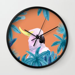 Cockatoo with tropical foliage and a coral background Wall Clock