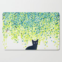 Cat in the garden under willow tree Cutting Board