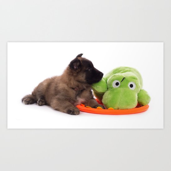 Puppy cuddling green toy Art Print