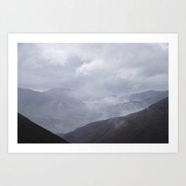 Rain clouds rolling through the mountains. Cumbria, UK. Art Print