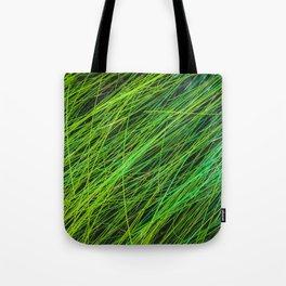closeup green grass field texture background Tote Bag