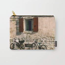 Two bikes against the wall Carry-All Pouch