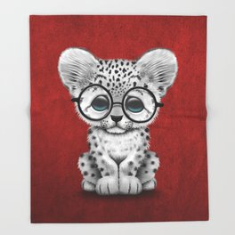 Cute Snow Leopard Cub Wearing Glasses on Deep Red Throw Blanket