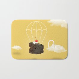 Isolated Chocolate cherry cake with parachute on yellow sky background Bath Mat