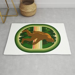 Bigfoot walking in the forests Rug