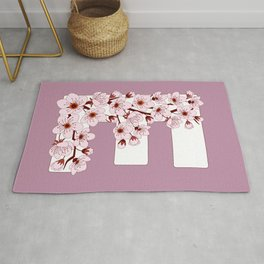 Colorful capital letter E patterned with sakura twig Rug