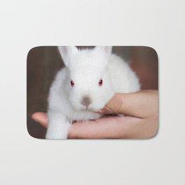 Bunny in hand Bath Mat