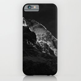 Sun shining on mountains iPhone Case