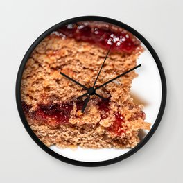 Detail of slice of chocolate cake with strawberry jam filling Wall Clock
