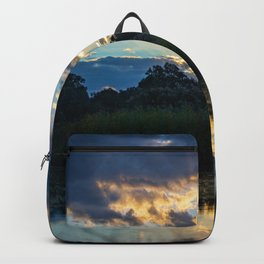 A Gorgeous Sunset Reflected in the Wetlands Backpack