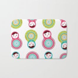 dolls matryoshka on white background, pink and blue colors Bath Mat