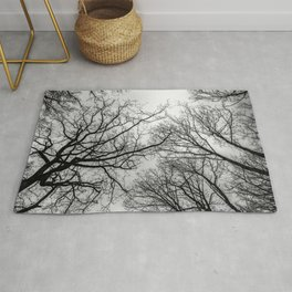 Mysterious trees, black and white Rug