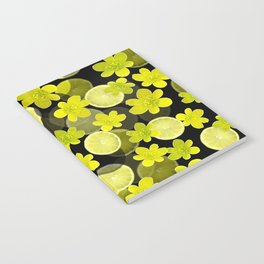 Lime and flowers on black Notebook