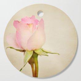 Single baby pink rose. Cutting Board