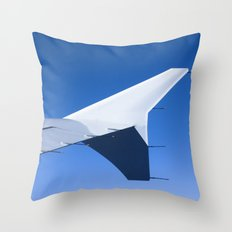 Airplane wing on a blue sky  Throw Pillow