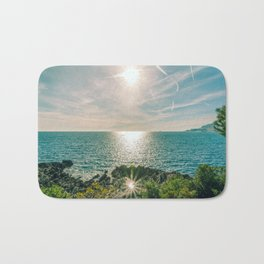 Sunlight reflected on the sea of Cap Martin in a sunny winter day Bath Mat