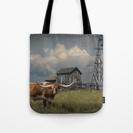 Longhorn Steer in a Prairie pasture by 1880 Town with Windmill and Old Gray Wooden Barn Tote Bag