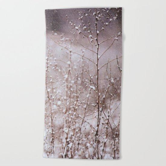 Snowy branches in the rain Beach Towel