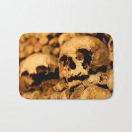 Skulls in the catacombs of Paris, France. Bath Mat