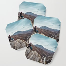 Girl sitting on the bench on the edge of the canyon with amazing view in front of her Coaster