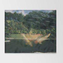 Koys in the landscape Throw Blanket