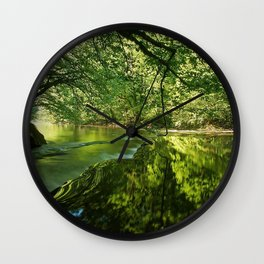 river, trees, light, grass Wall Clock