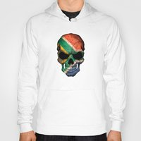 south africa Hoodies featuring Dark Skull with Flag of South Africa by Jeff Bartels