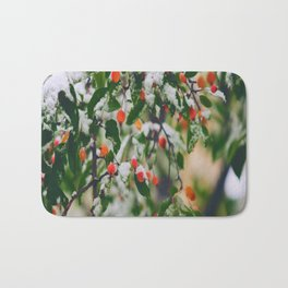 So many wild berries in the snow Bath Mat
