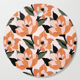 Bold orange poppy on a soft pink base Cutting Board