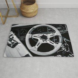 Steering Wheel Of A Sports Car Black White Rug