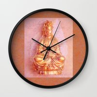 budi satria kwan Wall Clocks featuring Rose-Bronze Kwan Yin by Jan4insight
