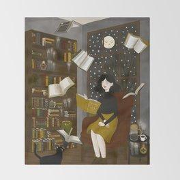 floating books Throw Blanket