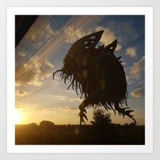 Monstre dans le soleil couchant Art Print