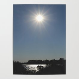 Silhouettes of two people on a rubber boat in a sunny reflection Poster