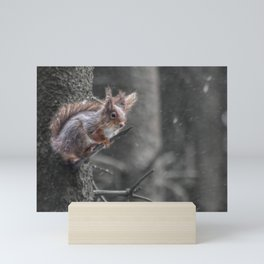 squirrel in the snow Mini Art Print