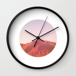 Mountain range photography in dark red, yellow and pink Wall Clock
