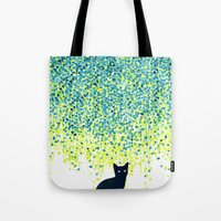 budi Tote Bags featuring Cat in the garden under willow tree by Picomodi