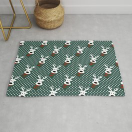 Reindeer in a snowy day (green) Rug