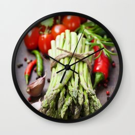 Fresh green asparagus bunch and vegetables on wooden board Wall Clock
