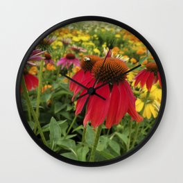 Red Echinacea standing out in a field of gold and orange Wall Clock
