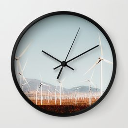 Wind turbine with mountain background in the desert at Kern County California USA Wall Clock