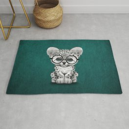 Cute Snow Leopard Cub Wearing Glasses on Teal Blue Rug