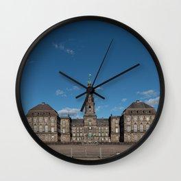 Christiansborg Palace under a blue sky on a sunny day Wall Clock
