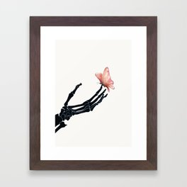 Butterfly on Skeleton Hand Framed Art Print