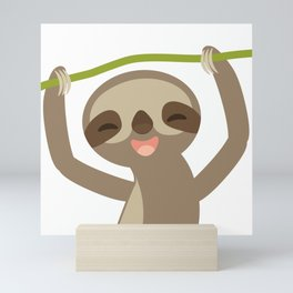 funny and cute smiling Three-toed sloth on green branch Mini Art Print