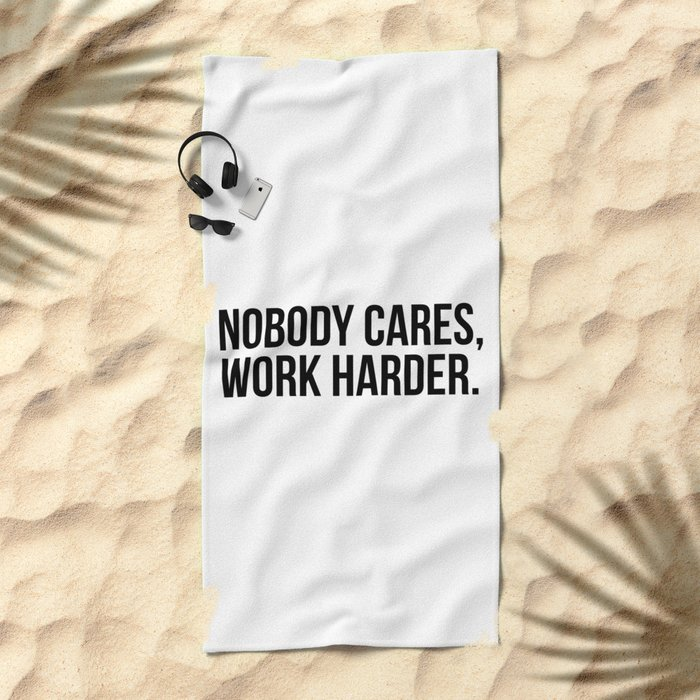 Nobody cares, work harder. Beach Towel