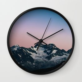 Hiking up mountains Wall Clock